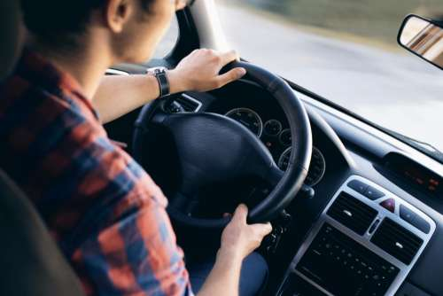 people man guy dashboard steering wheel