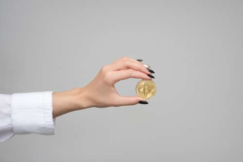 bitcoin finance cryptocurrency hand money