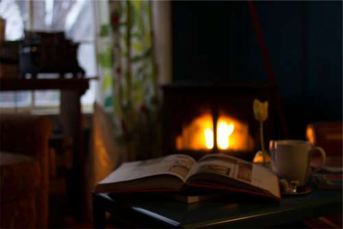 book pages reading fireplace flame