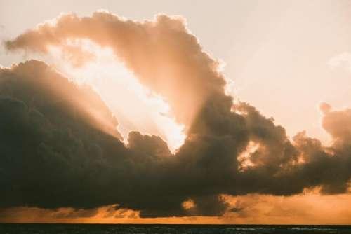 sea water horizon sunset clouds