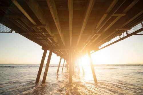 wooden bridge sea ocean water
