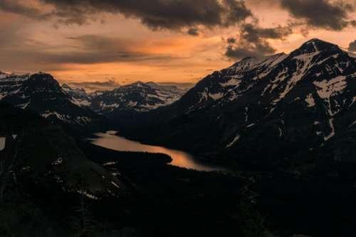 mountains sunset dusk sky clouds
