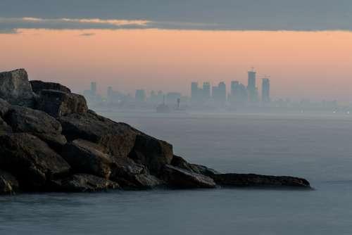 ocean city skyline water rocks