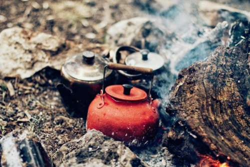 fire ashes smoke kettles pots