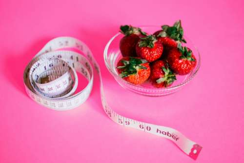 tape measure strawberries healthy weight