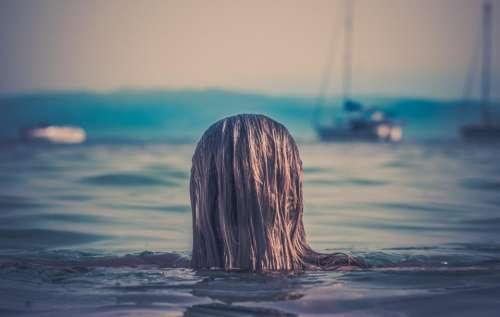 girl swimming lake ocean sea