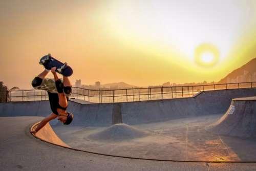 skateboarder sunset flip action dawn