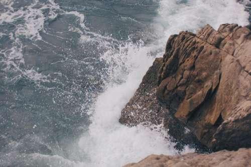 rocks cliffs coast water waves