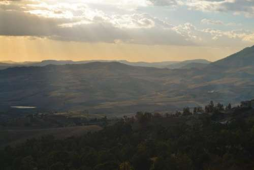 sunbeams landscape fields hills valleys