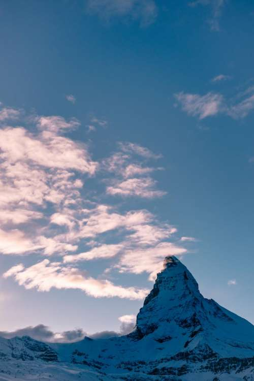 cliff summit peak mountain snow