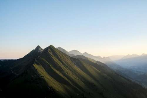 nature mountains summit peaks lush