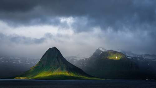 moody landscape mountain clouds ocean