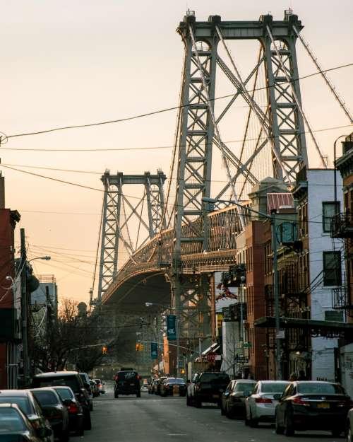 city street bridge dusk cars
