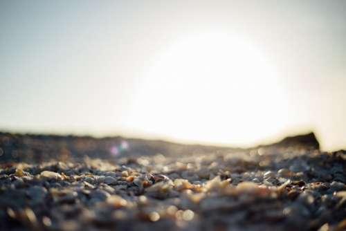 sunset sunshine beach rocks pebbles