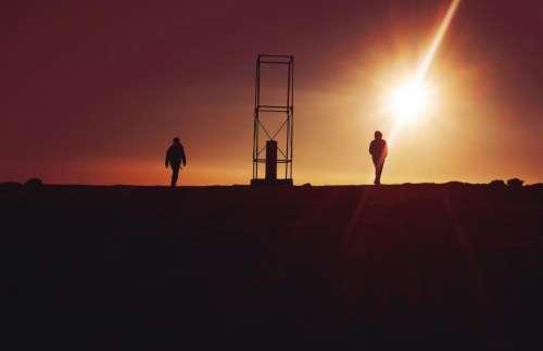 people walking silhouette sun sunlight