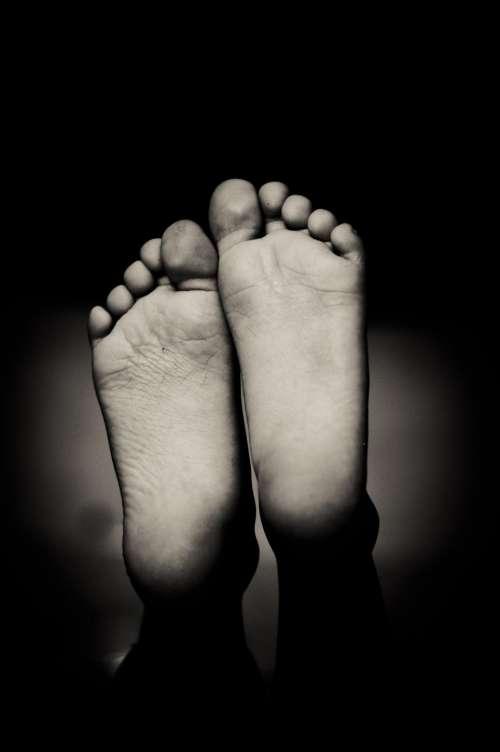 dark black and white foot
