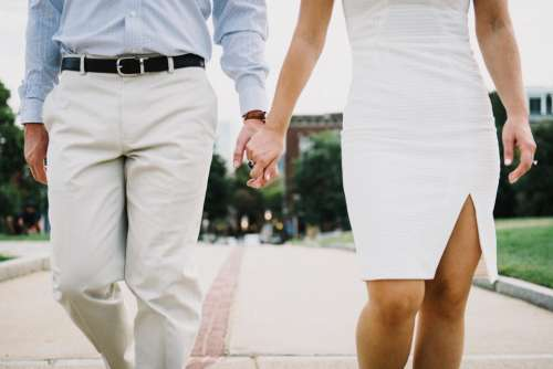 couple white holding hands formal walking