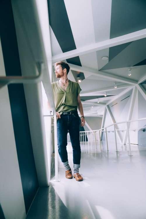 casual man indoors standing portrait