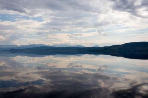 lake water mountain horizon sky