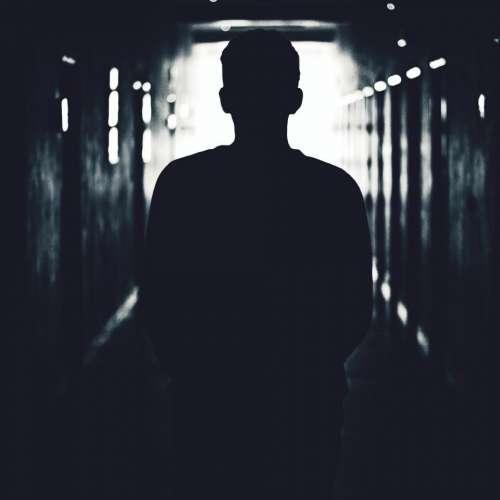 people man walking alone dark