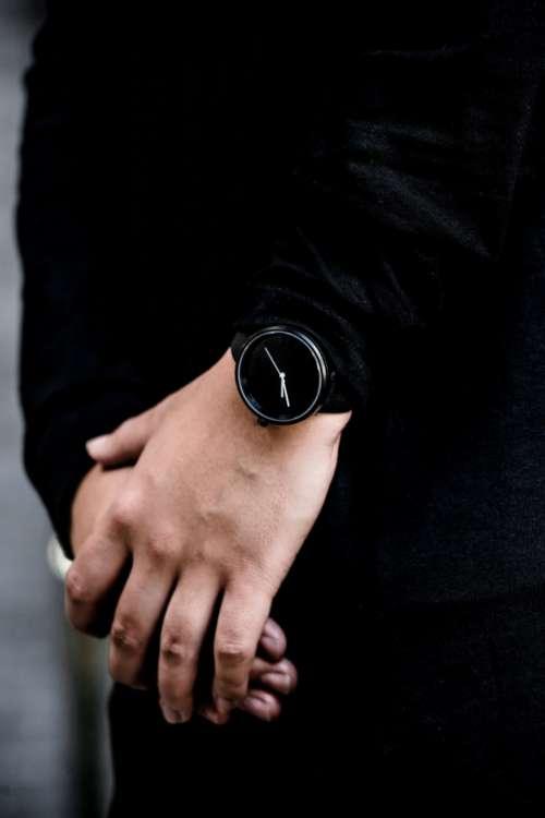 black fashion watch wristwatch time