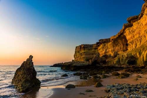 seascape blue sky rock sea ocean
