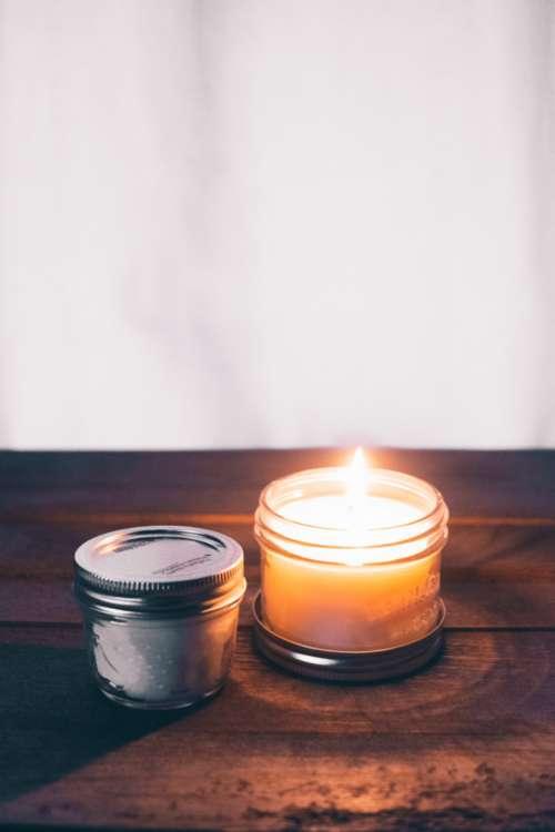 burning candle jar white lid