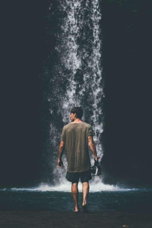 man adventure waterfall holiday vacation