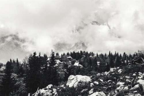 landscape houses rocks boulders trees