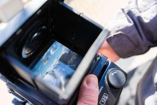 holding camera closeup analog camera operator