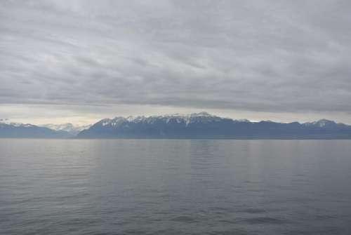 Switzerland landscape mountains water clouds