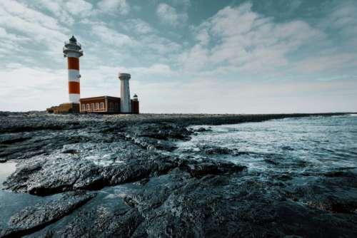lighthouse sea day ocean water