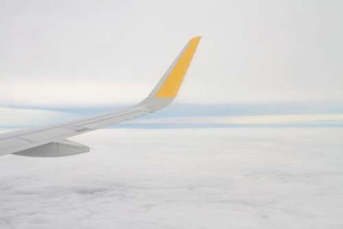 airplane airline travel trip cloudy