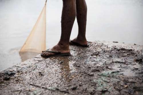 people man dirt mud slippers