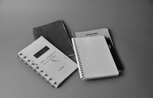black and white notes notebook string paper