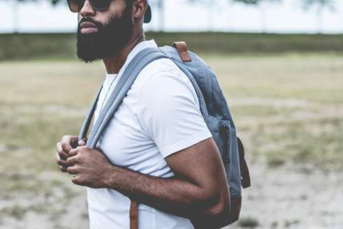 guy man beard sunglasses backpack