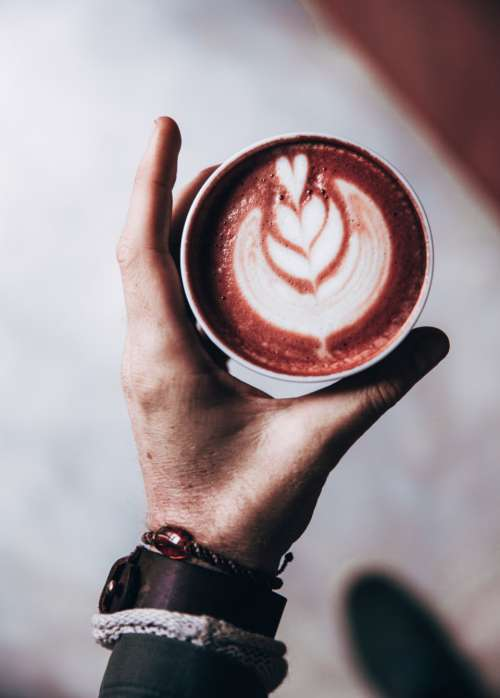 latte art hand close up drink