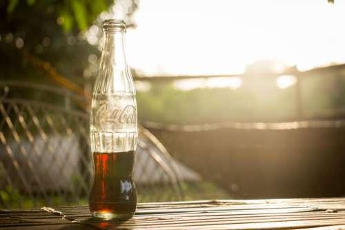 coke company drink bottle beverage