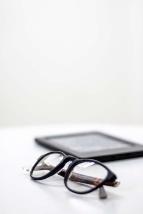 glasses white table tablet reading