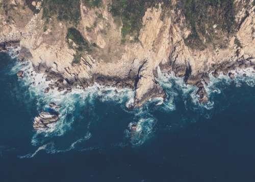 mountains cliffs rocks coast ocean