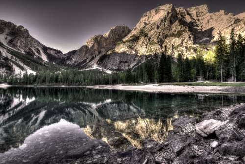 lake lakeside surreal dolomites mountains