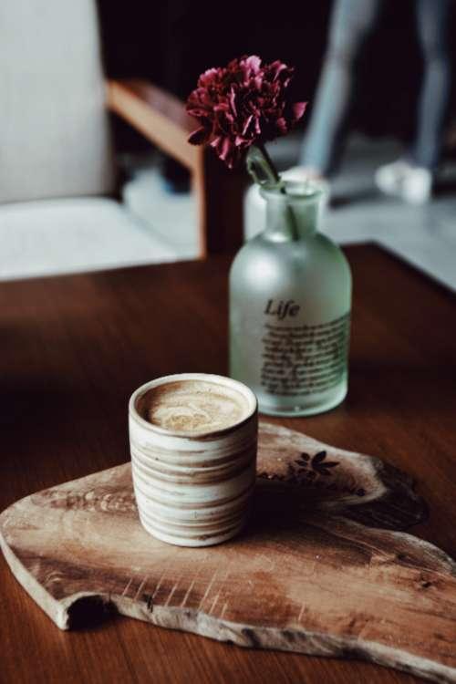 coffee flowers bottle wood table