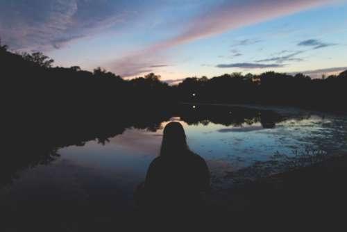 people girl sitting alone dark