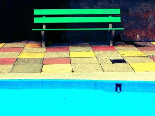 green bench blue pool tiles