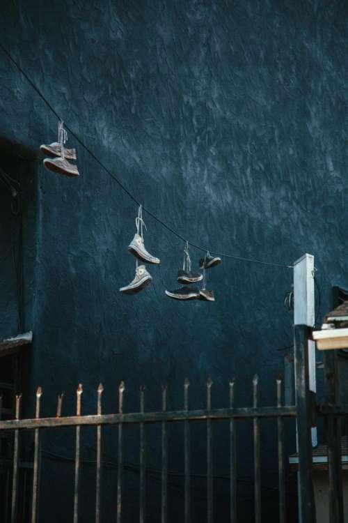 shoes footwear hang fence gate