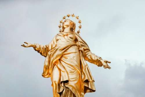gold statue crown madonnina italy