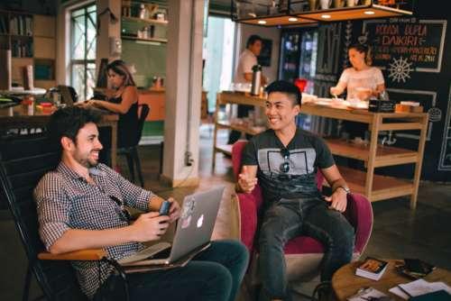 man coffeeshop laptop meeting business