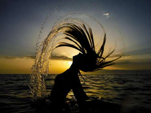 girl people swimming dark sunset