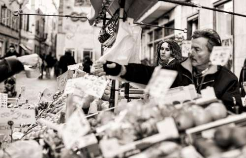 people man woman market black and white