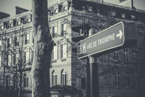arc de triomphe road sign direction arrow